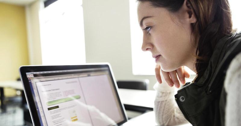 A girl looking at a monitor