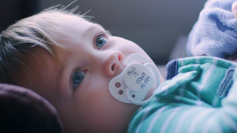 A liitle baby with pacifier