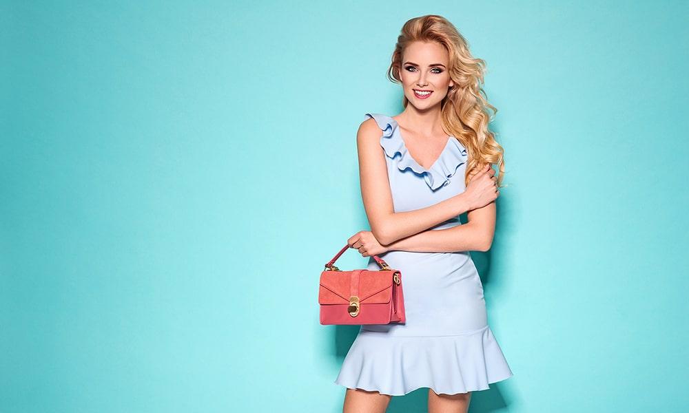 Blonde woman in a blue dress.