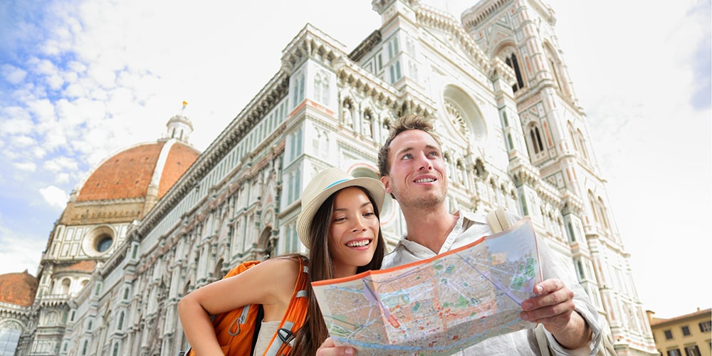 A couple holding a map.