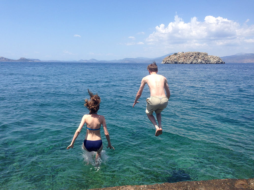 Couple jumping into the water.