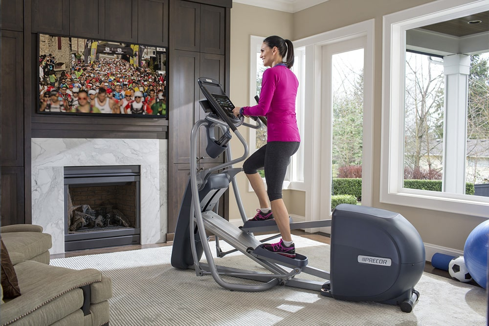 Woman working out on elliptical.