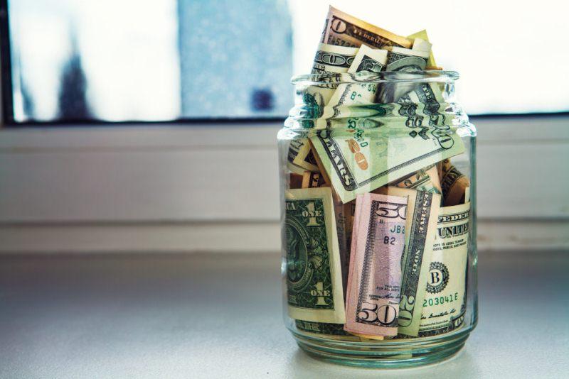 Dollar notes in a jar