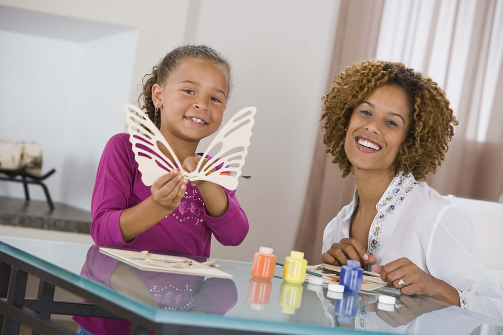 Woman and girl making paper crafts.