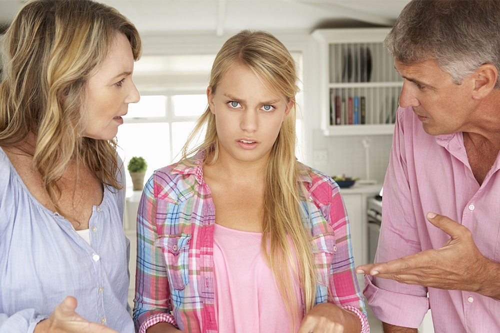 Parents are talking to a teenage daughter.