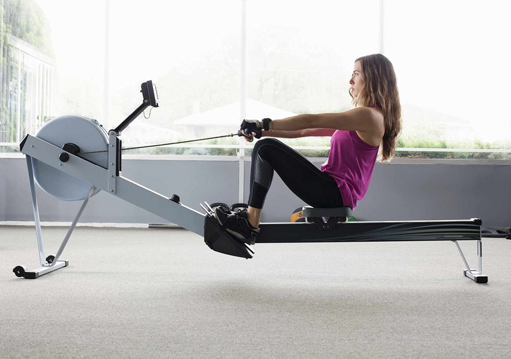 Woman working out on rowing machine.