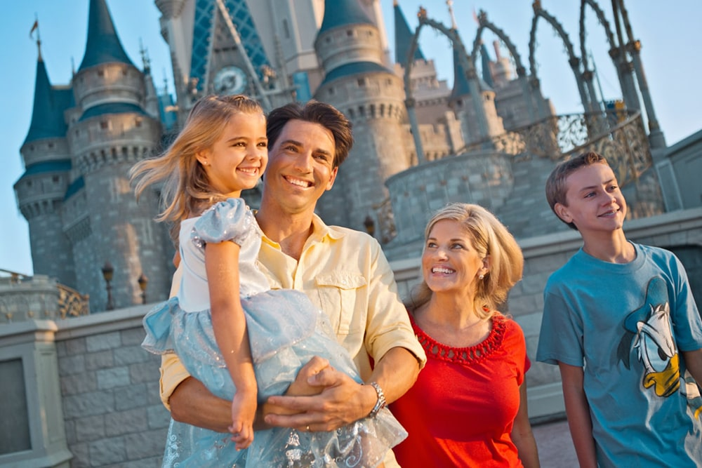 Smiling family in Disneyland.