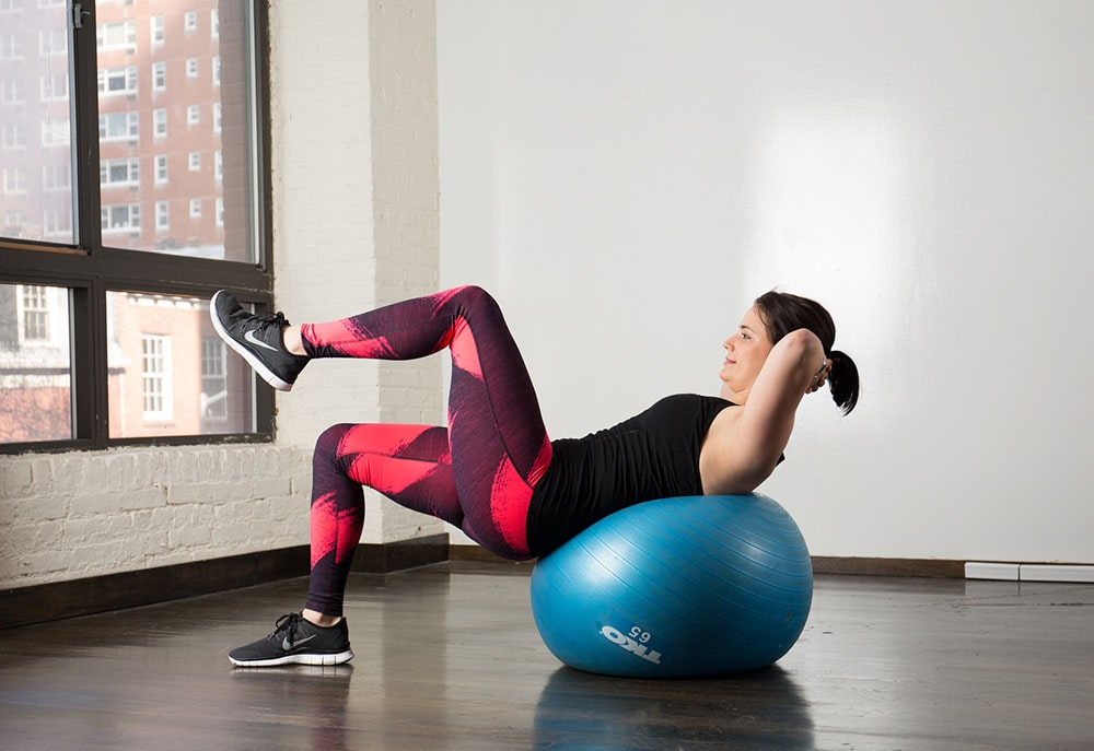 Woman working out with stability ball.