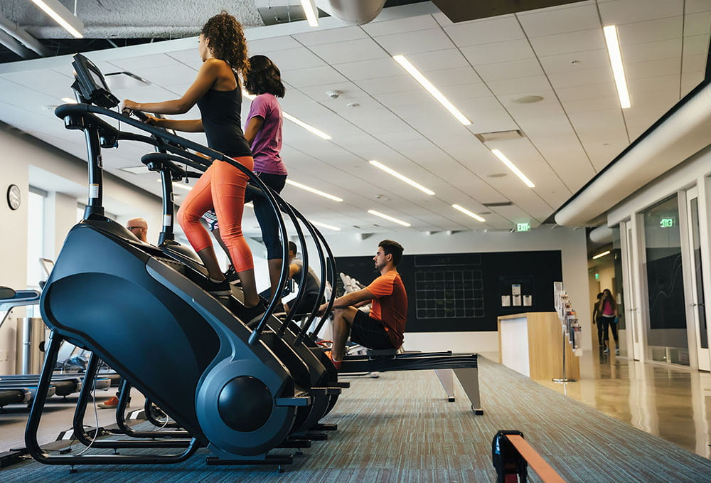 Women working out on stair mills.