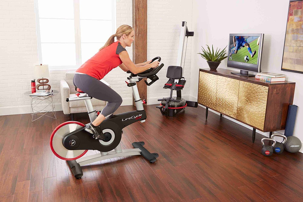 Woman working out on stationary bike.