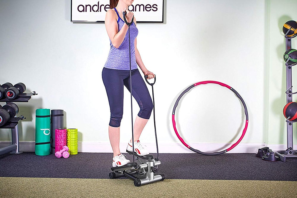 Woman working out on stepper machine.
