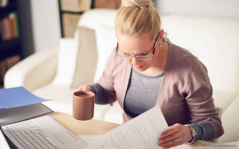 A woman looking at tax forms