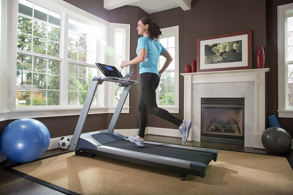 Woman working out on treadmill.