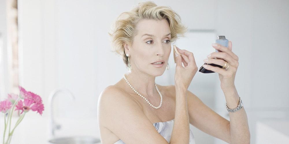 Woman applying make up.