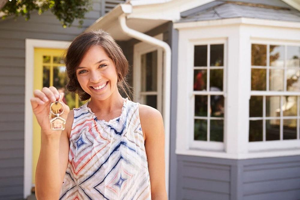 Woman holding house keys.