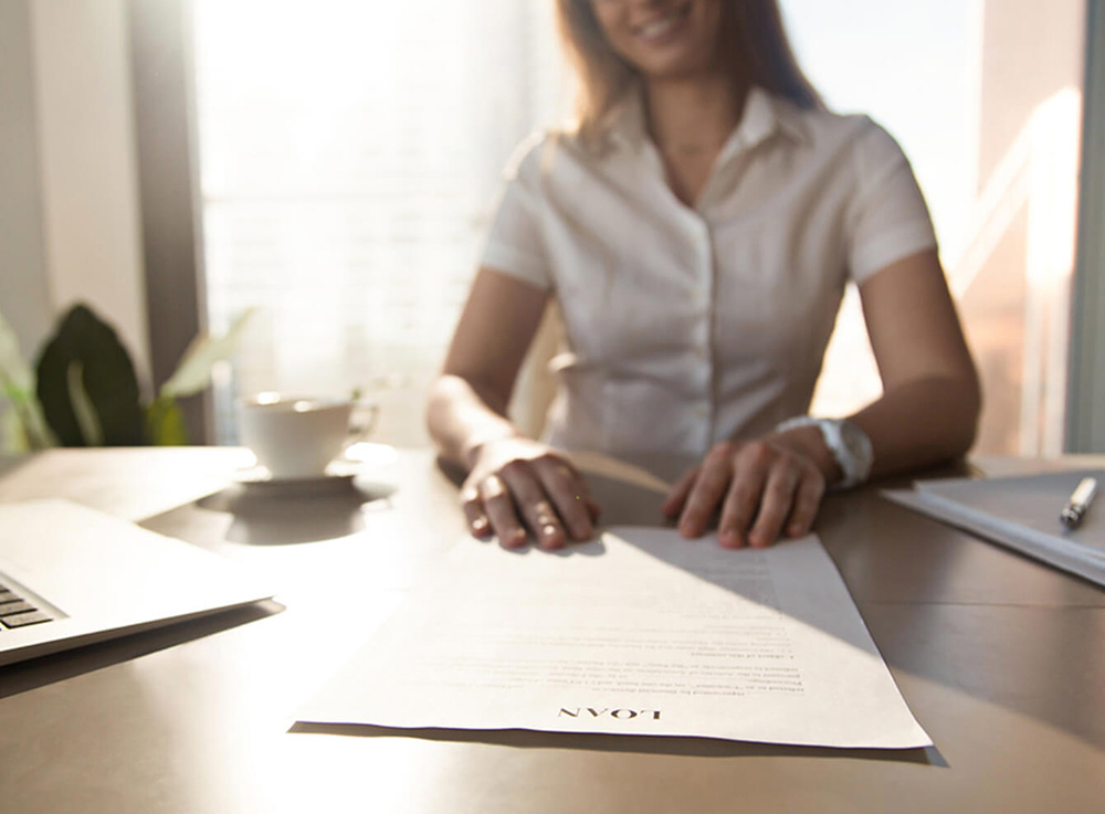 Woman with a loan agreement.