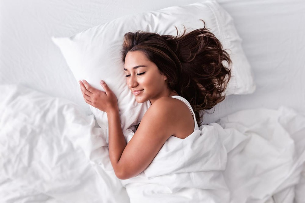 Woman smiles in a dream.
