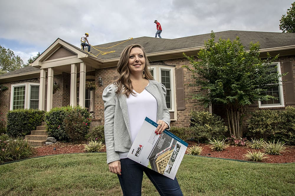 Woman controlling house roofing.