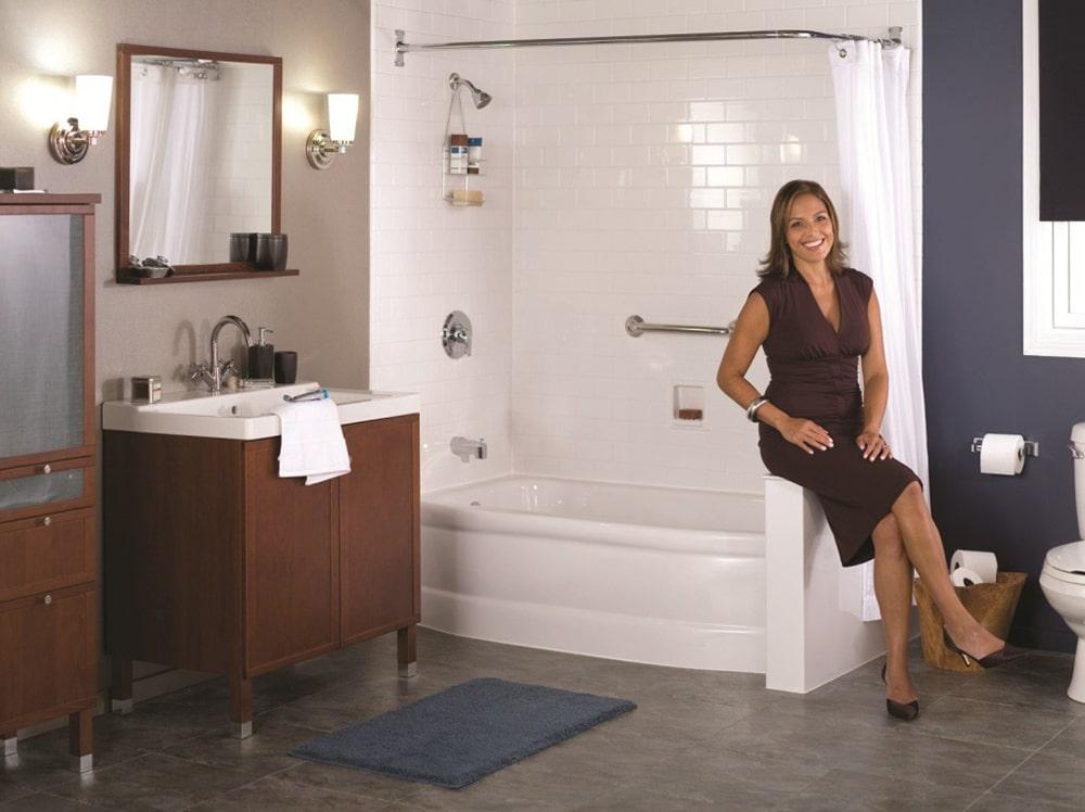 Woman sitting on a bath.